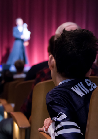 Boy watching theatre